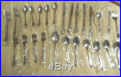 26 Pieces in the Calla Lily Pattern Oneida Deluxe Stainless Flatware Unused