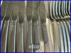 Vintage Oneida stainless steel 12 place with extras satin handles excellent cond
